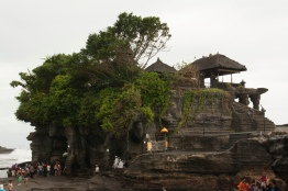 Tanah Lot, carved into the large rock which was shaped over time by the ocean tides.